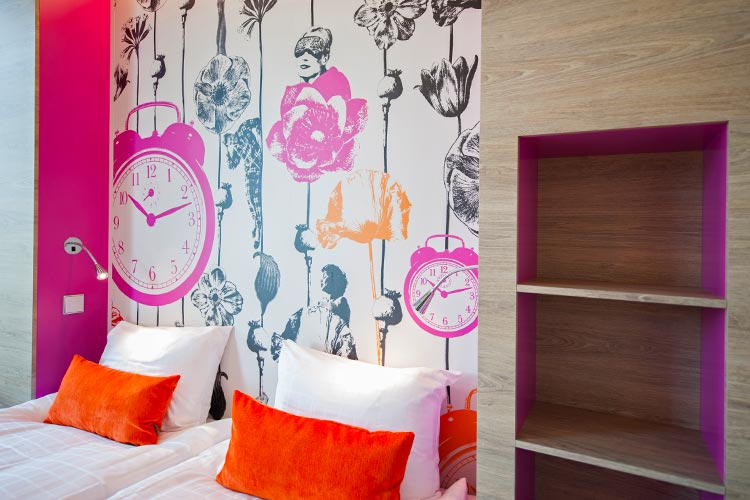 Motel L: beddroom with fond wall designed by Lisa Bengtsson